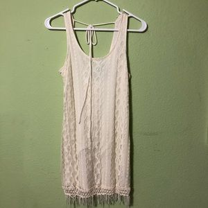 Off-white lace dress with fringe